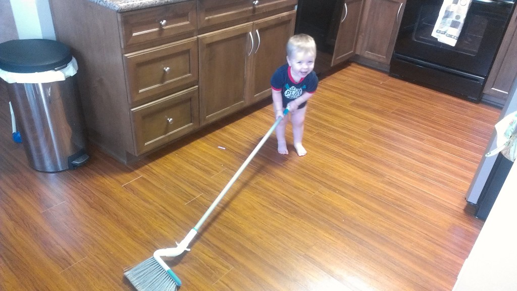 "Josh, about 18 months old, ""helping"" with sweeping the kitchen"